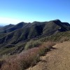 Looking eastward from the ridge, back at the Gridley Trail I had climbed, and seeing the ocean beyond the valley.
