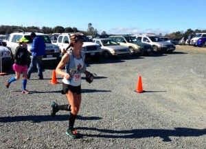 Running through the first aid station around Mile 8 (thanks to Christy Bentivoglio for the photo).
