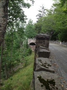 One of the stone guardrails and bridges engineered by Rockefeller.