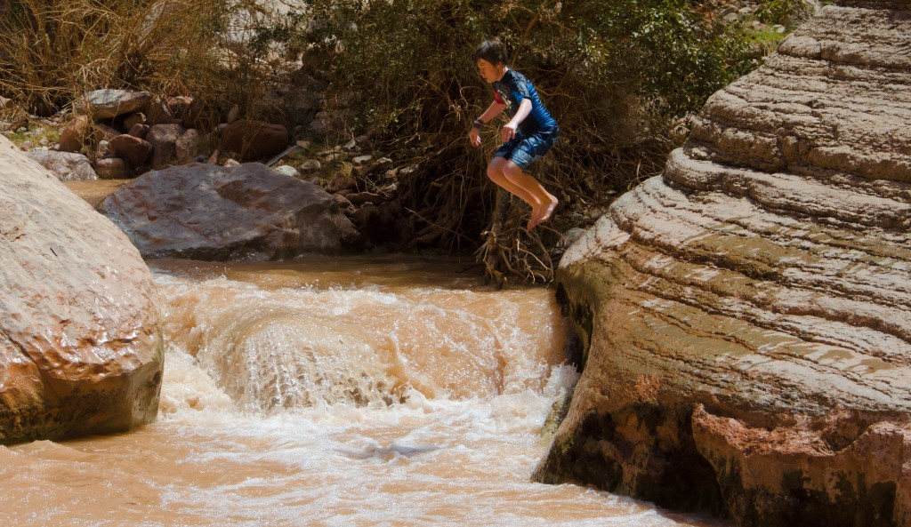 Kyle jumping into a side stream.