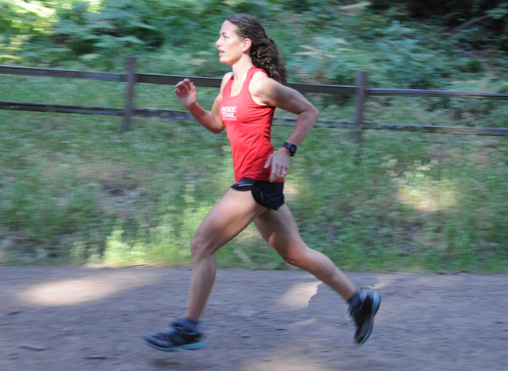 Running strong in June, in spite of a growing pain in my foot and back. (photo by Jenn Fox)