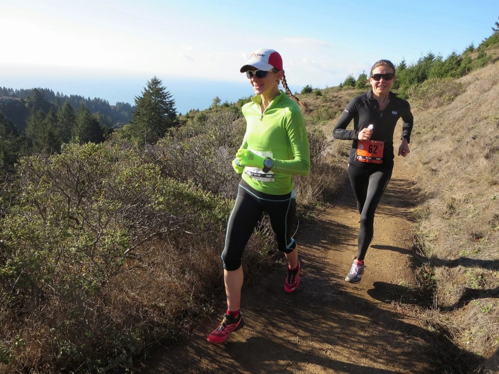 Caitlin Smith in front pacing Magdalena Boulet to a 2nd place finish at the 2013 North Face Endurance Challenge 50-mile championship. (Photo by Leor Pantilat via Facebook)