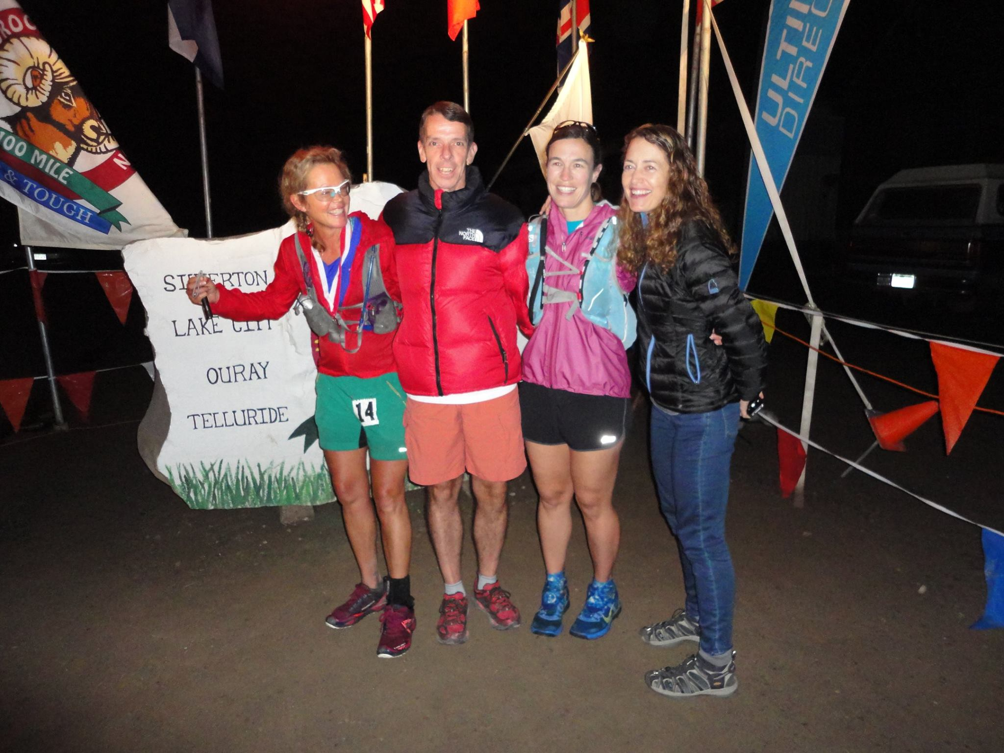 Betsy far left with her three pacers -- Jack, Helen and me -- after she kissed the rock at the finish, around 12:30 p.m.