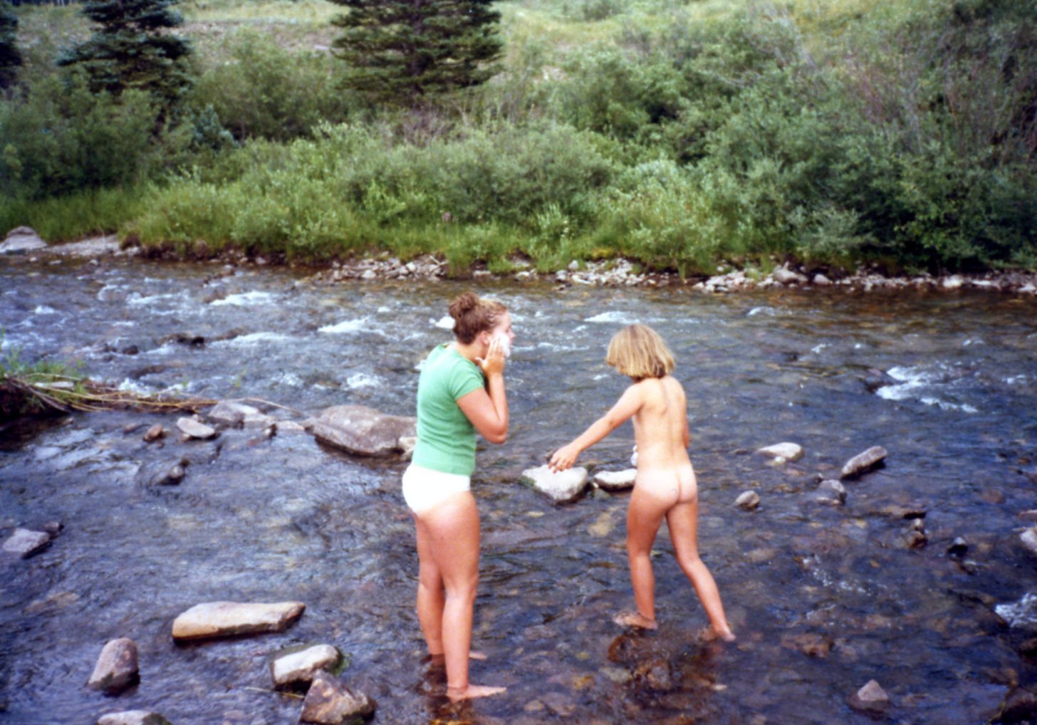Martha and Sarah in a river 1978