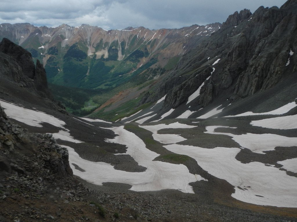 Remnants of storm clouds over Oscar Pass as seen from Grant Swamp Pass. These are the two passes leading to Telluride. Hardrock runners go over multiple mountain passes like this. Photo by Chihping Fu