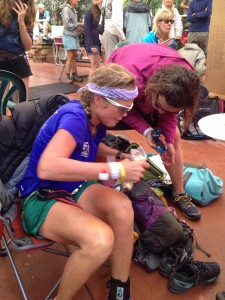 Helen Pelster helps Betsy Nye at the Telluride Aid Station.