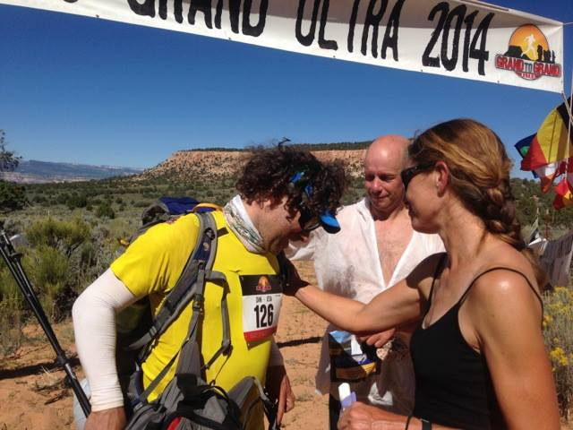 My tentmate Dan Owings finishing the long stage, being congratulated by me and our other tentmate Danny.