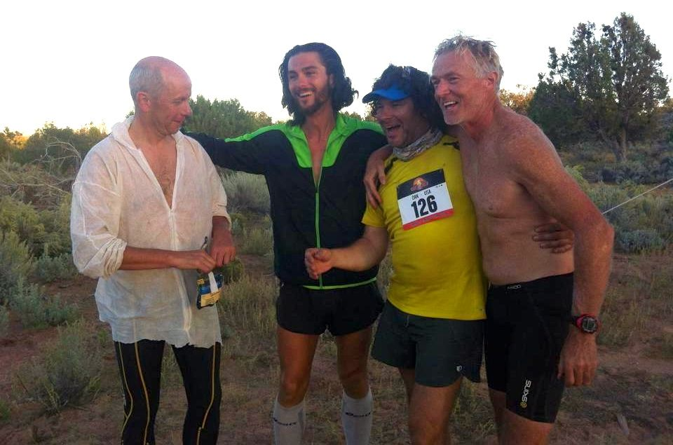 Danny, Michele and Simon congratulate Dan (in yellow) for finishing a stage.
