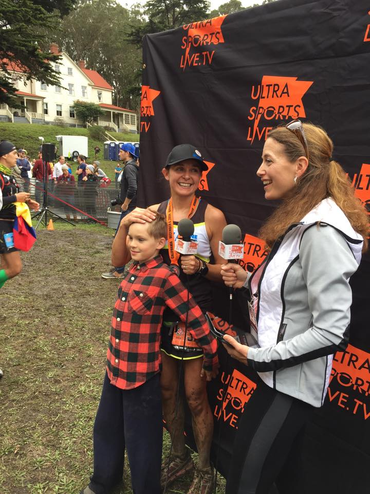 Interviewing women's champion Magdalena Boulet (pictured with her son).