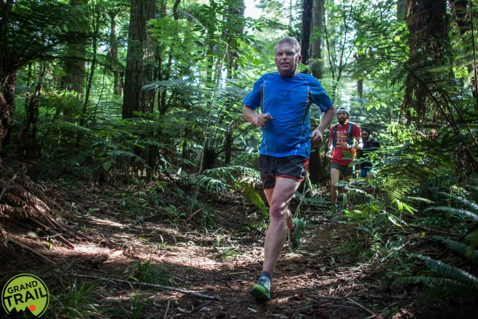 Tarawera Ultra founder Paul Charteris followed by top competitor Michael Wardian running through The Redwoods as part of the forest rogaine, a warm-up and fun event before the race.