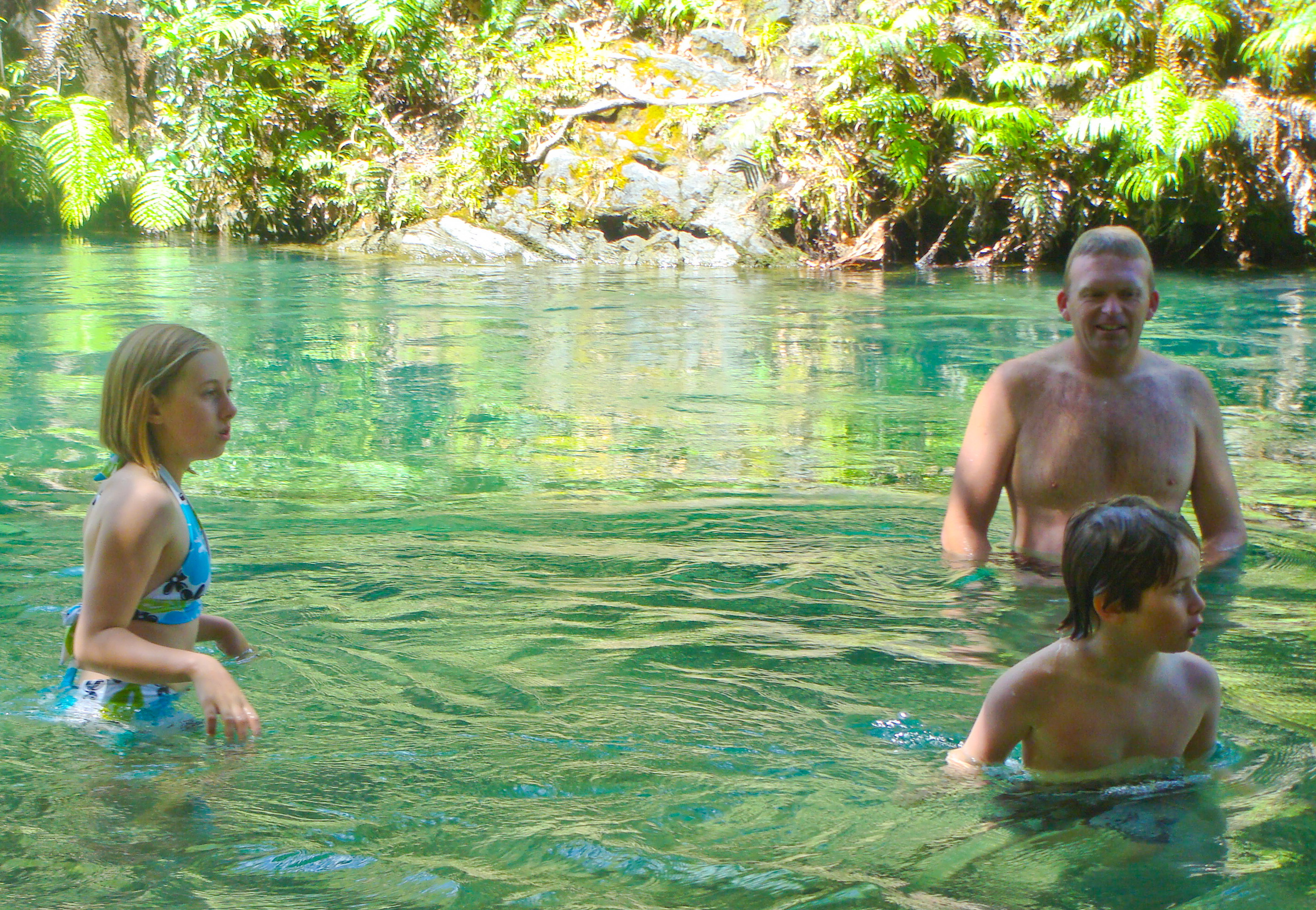 My kiddos Colly and Kyle swimming in the river next to the Tarawera race course, with Paul Charteris, in January 2010.