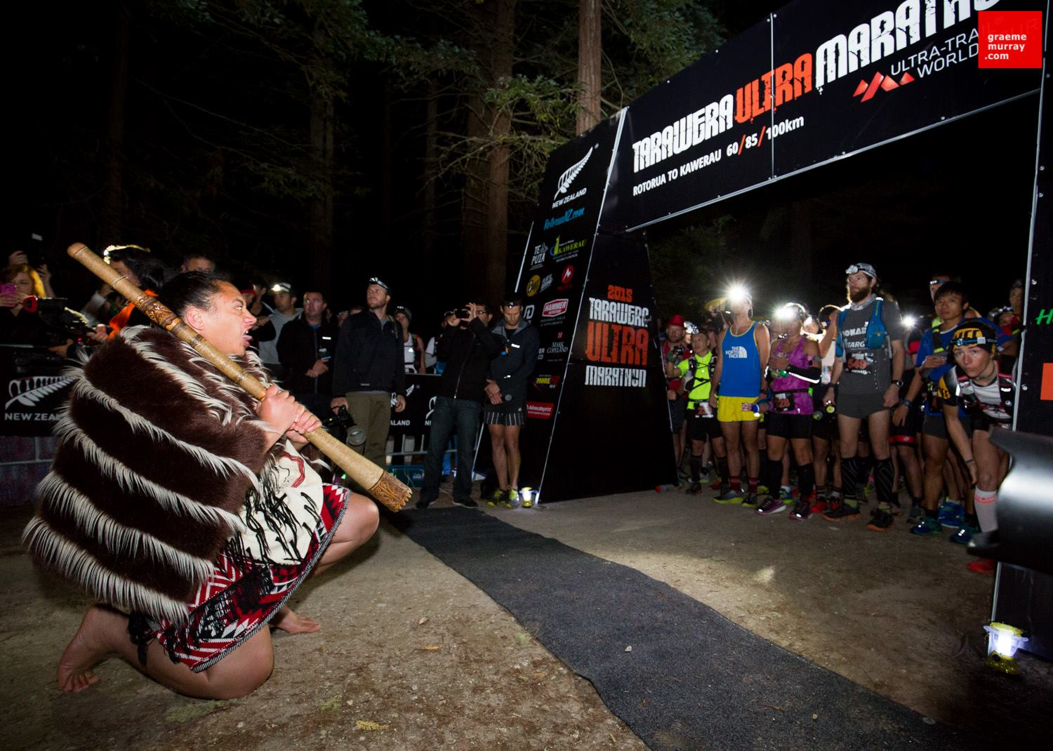A ceremonial dance at the start line, with the elite runners looking on. Photo by Graeme Murray courtesy of Tarawera Ultra.