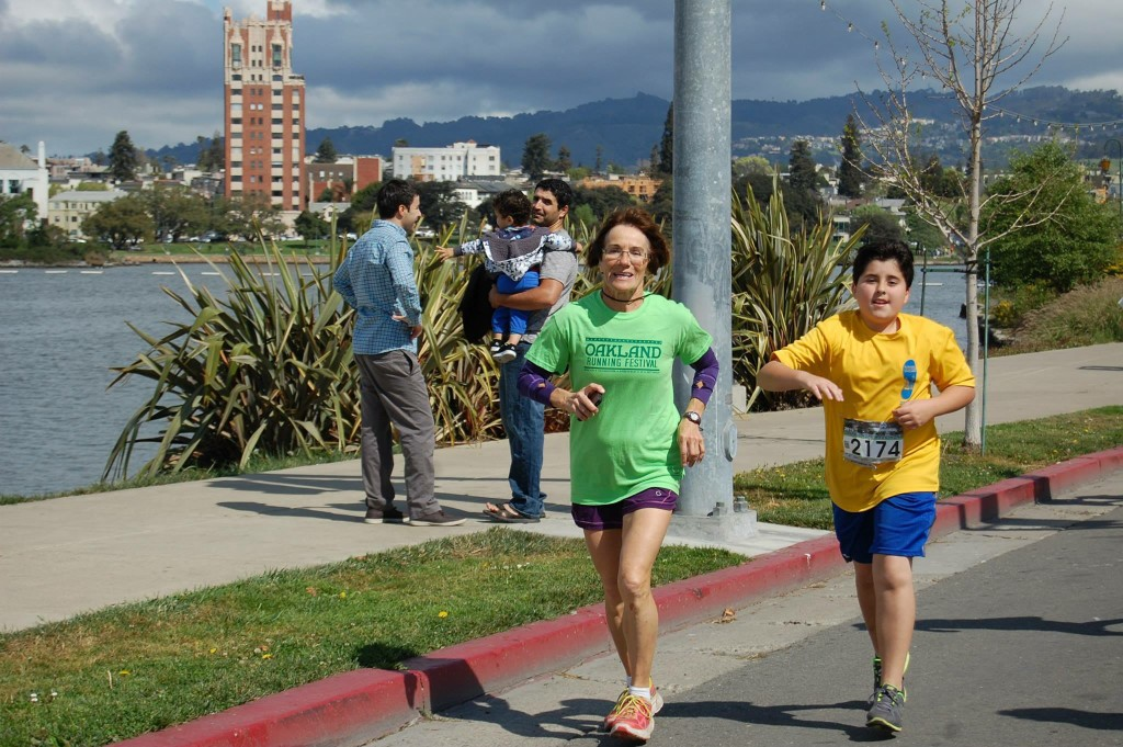 Christine helping a sixth-grade participant finish yesterday's half marathon. Photo courtesy RBO's Facebook page.