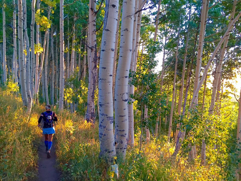 We ran through innumerable pretty aspen groves, like this one, which was a relief from the direct sun! This is of runner Wendy Clark by Matt Clark.