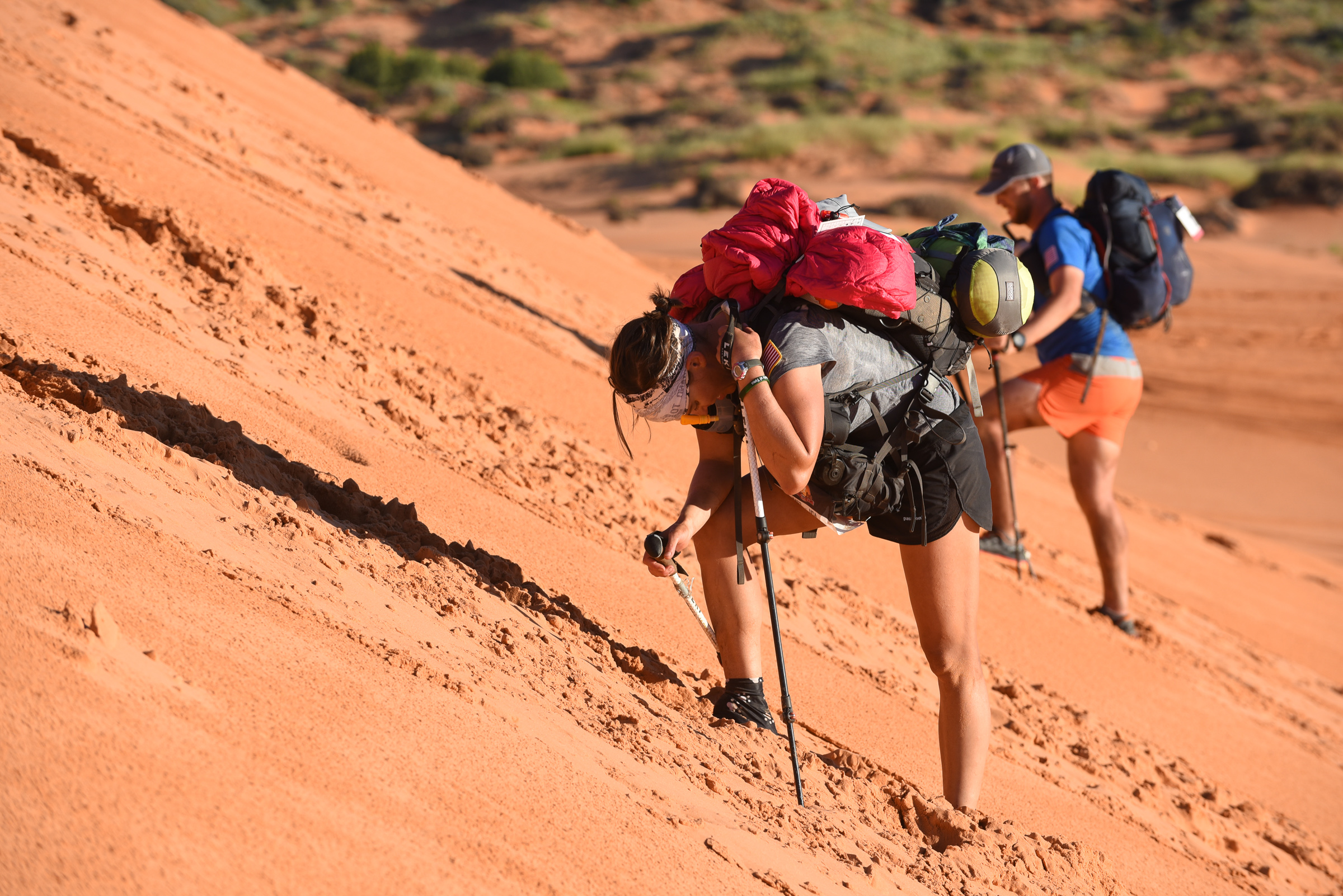 A couple of unidentified participants climbing the dunes toward the end of the 52-mile Stage 3 long stage. Jami had passed through hours ahead of them, in the nighttime.
